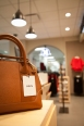 This versatile small tote bag is available in black and brown $104.90.